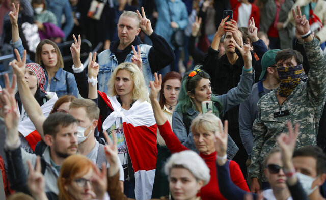 People gesture during a protest at the Independence Square in Minsk, Belarus, Thursday, Aug. 27, 2020. Police in Belarus have dispersed protesters who gathered on the capital's central square, detaining dozens. (AP Photo/Sergei Grits)