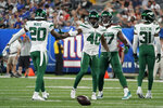 New York Jets cornerback Javelin Guidry (40) celebrates with safety Marcus Maye (20) after a blocked pass in the first half of the team's NFL preseason football game New York Giants, Saturday, Aug. 14, 2021, in East Rutherford, N.J. (AP Photo/Corey Sipkin)