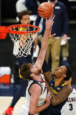 West Virginia's Gabe Osabuohien (3) shoots against Gonzaga's Drew Timme, left, during the first half of an NCAA college basketball game Wednesday, Dec. 2, 2020, in Indianapolis. (AP Photo/Darron Cummings)