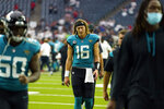 Jacksonville Jaguars quarterback Trevor Lawrence (16) walks off the field after an NFL football game against the Houston Texans Sunday, Sept. 12, 2021, in Houston. The Texans won 37-21. (AP Photo/Sam Craft)