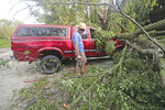 Adam Turley surveys the damage to his dad's truck in front of their home on Concord Center Drive in the Town of Concord, Wis., on Thursday, July 29, 2021. A line of thunderstorms arrived early Thursday generating numerous tornado warnings as well as high winds and near-constant lightning.  (Mike De Sisti/Milwaukee Journal-Sentinel via AP)