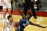 Wisconsin's Micah Potter shoots past Rhode Island's Makhi Mitchell during the second half of an NCAA college basketball game Wednesday, Dec. 9, 2020, in Madison, Wis. (AP Photo/Morry Gash)