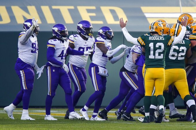 Green Bay Packers' Aaron Rodgers reacts to a two-point conversion during the second half of an NFL football game against the Minnesota Vikings Sunday, Nov. 1, 2020, in Green Bay, Wis. (AP Photo/Matt Ludtke)
