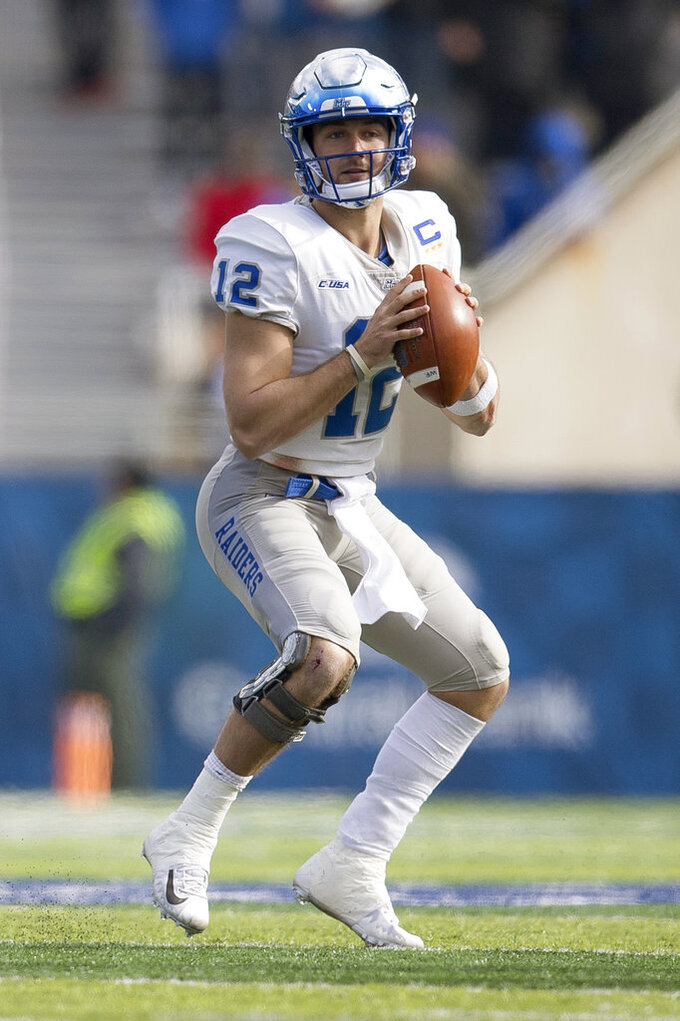 Middle Tennessee quarterback Brent Stockstill (12) prepares to pass the ball during the first half of an NCAA college football game against Kentucky in Lexington, Ky., Saturday, Nov. 17, 2018. (AP Photo/Bryan Woolston)