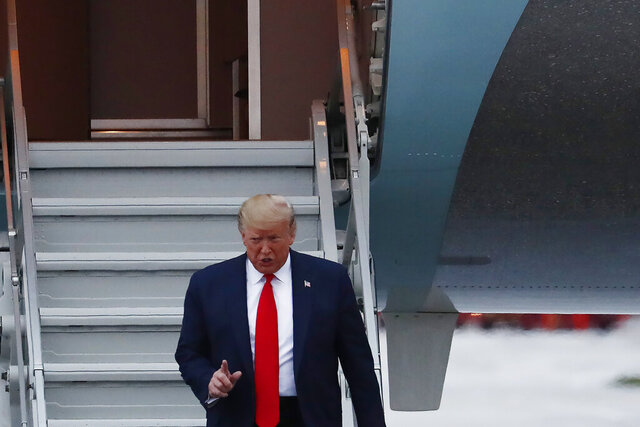 President Donald Trump arrives to the Miami International Airport on Thursday, Jan. 23, 2020, in Miami. (AP Photo/Brynn Anderson)