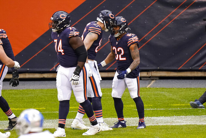 Chicago Bears running back David Montgomery (32) celebrates a touchdown against the Detroit Lions in the first half of an NFL football game in Chicago, Sunday, Dec. 6, 2020. (AP Photo/Nam Y. Huh)