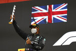 Second placed Mercedes Lewis Hamilton celebrates on the podium at the end of the Emilia Romagna Formula One Grand Prix, at the Imola racetrack, Italy, Sunday, April 18, 2021. (Bryn Lennon/ Pool Via AP)