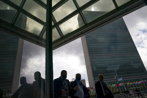 Pedestrians pass along the United Nations headquarters, Wednesday, Sept. 22, 2021, during the 76th Session of the U.N. General Assembly in New York.. (AP Photo/John Minchillo)