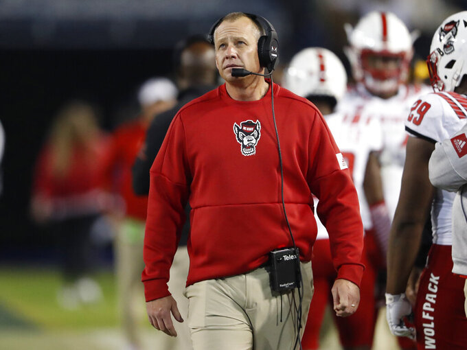 FILE - In this Nov. 21, 2019, file photo, North Carolina State coach Dave Doeren paces on the sideline during the second half of the team's NCAA college football game against Georgia Tech in Atlanta. No. 24 Pittsburgh will try to get off to its first 4-0 start since 2000 when the Panthers host North Carolina State on Saturday, Oct. 3, 2020. .(AP Photo/John Bazemore, File)