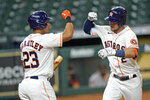 Houston Astros' Alex Bregman (2) celebrates with Michael Brantley (23) after hitting a home run against the San Francisco Giants during the third inning of a baseball game Tuesday, Aug. 11, 2020, in Houston. (AP Photo/David J. Phillip)
