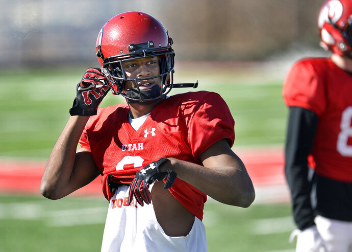 In this Saturday, March 10, 2018 photo, Utah wide receiver Bronson Boyd adjusts his helmet during spring NCAA college football practice in Salt Lake City. Boyd will get a chance to play for the first time in nearly two years when he takes the field for Utah in the fall. The redshirt freshman sat out in 2017 after joining the Utes following his dismissal from Texas Tech. (Scott Sommerdorf/The Salt Lake Tribune, via AP)