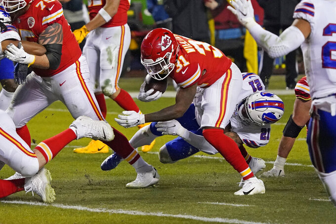 Kansas City Chiefs running back Darrel Williams (31) breaks a tackle by Buffalo Bills safety Jordan Poyer (21) during a 6-yard touchdown run in the first half of the AFC championship NFL football game, Sunday, Jan. 24, 2021, in Kansas City, Mo. (AP Photo/Jeff Roberson)