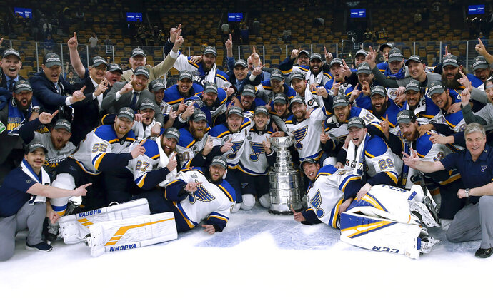 FILE - In this June 12, 2019, file photo, the St. Louis Blues celebrate with the Stanley Cup after they defeated the Boston Bruins in Game 7 of the NHL Stanley Cup Final in Boston. The ebb and flow of recent champions from fast and skilled to physical and punishing illustrates how many different blueprints there are to win a championship in today's NHL and the importance of tailoring style of play to personnel and perfecting that chemistry. (AP Photo/Michael Dwyer, File)