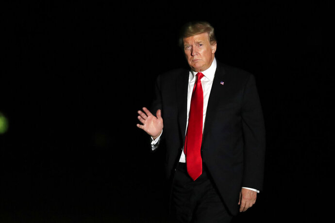 President Donald Trump waves upon arrival at the White House in Washington, from a campaign rally in Montoursville, Pa., Monday, May 20, 2019. (AP Photo/Manuel Balce Ceneta)