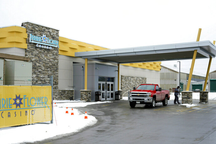 FILE - In this Feb. 14, 2019 file photo, a vehicle is parked outside the Ponca Tribe's Prairie Flower Casino in Carter Lake, Iowa. The Ponca Tribe of Nebraska has secured another win in its fight with Iowa and Nebraska to keep the Prairie Flower Casino open in western Iowa. The National Indian Gaming Commission ruled in the tribe's favor Wednesday, May 1, 2019, saying it has the right to operate the casino on land it acquired in Carter Lake, Iowa. Nebraska, Iowa and the neighboring city of Council Bluffs, Iowa, sued to close the casino, saying the tribe had misrepresented its plans for the site. (AP Photo/Nati Harnik, File)
