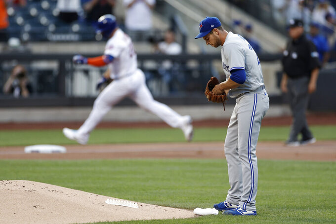Toronto Blue Jays pitcher Steven Matz stands near the mound after giving up a two-run home run to New York Mets' Pete Alonso during the first inning of a baseball game Friday, July 23, 2021, in New York. (AP Photo/Adam Hunger)