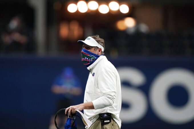 Florida head coach Dan Mullen watches play against Alabama during the second half of the Southeastern Conference championship NCAA college football game, Saturday, Dec. 19, 2020, in Atlanta. (AP Photo/Brynn Anderson)
