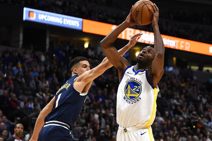 FILE - In this March 3, 2020, file photo, Golden State Warriors guard Andrew Wiggins (22) shoots against Denver Nuggets forward Michael Porter Jr. (1) during an NBA basketball game in Denver. With Klay Thompson sidelined, Wiggins embraces a bigger load. (AP Photo/John Leyba, File)