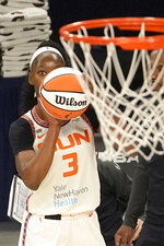 Connecticut Sun's Kaila Charles eyes the basket prior to scoring during the first quarter of a WNBA basketball game against the Chicago Sky Thursday, June 17, 2021, in Chicago. (AP Photo/Charles Rex Arbogast)