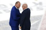 Vegas Golden Knights coach Gerard Gallant, left, shakes hands Washington Capitals coach Barry Trotz, right, after the Capitals defeated the Golden Knights 4-3 in Game 5 of the NHL hockey Stanley Cup Finals on Thursday, June 7, 2018, in Las Vegas. (AP Photo/Ross D. Franklin)