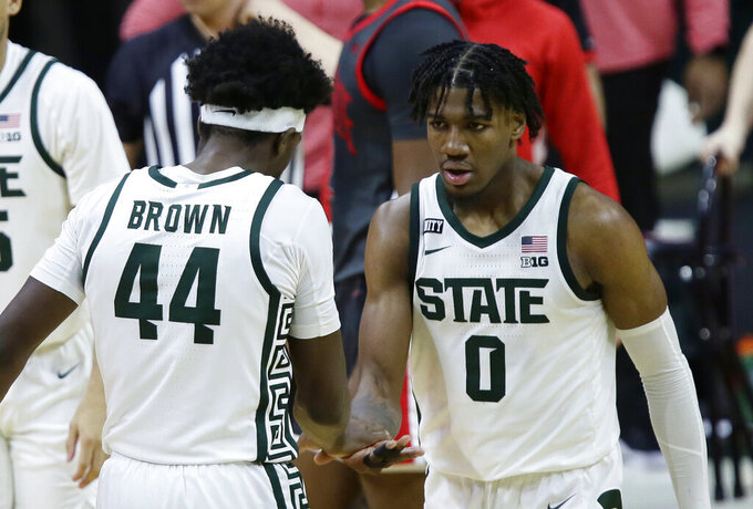 Michigan State forward Aaron Henry (0) celebrates with forward Gabe Brown (44) after scoring against Ohio State during the second half of an NCAA college basketball game Thursday, Feb. 25, 2021, in East Lansing, Mich. (AP Photo/Duane Burleson)