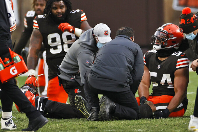 Cleveland Browns defensive end Olivier Vernon (54) grimaces after an injury during the second half of an NFL football game against the Pittsburgh Steelers, Sunday, Jan. 3, 2021, in Cleveland. (AP Photo/Ron Schwane)