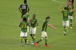 Portland Timbers' Yimmi Chara (23) is congratulated for his goal against the Seattle Sounders during the first half of an MLS soccer match Wednesday, Sept. 23, 2020, in Portland, Ore. (Sean Meagher/The Oregonian via AP)