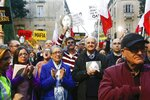 Rose Vella, center left, mother of late Daphne Caruana Galizia, and father of Daphne, Michael Vella, attend a protest in La Valletta, Malta, Sunday, Dec. 1, 2019. Malta's embattled prime minister has received a pledge of confidence from Labor Party lawmakers amid demands for his resignation by citizens angry over alleged links of his former top aide to the car bomb killing of a Maltese anti-corruption journalist. Hours later, thousands of Maltese protested outside a courthouse demanding that Joseph Muscat step down. (AP Photo)