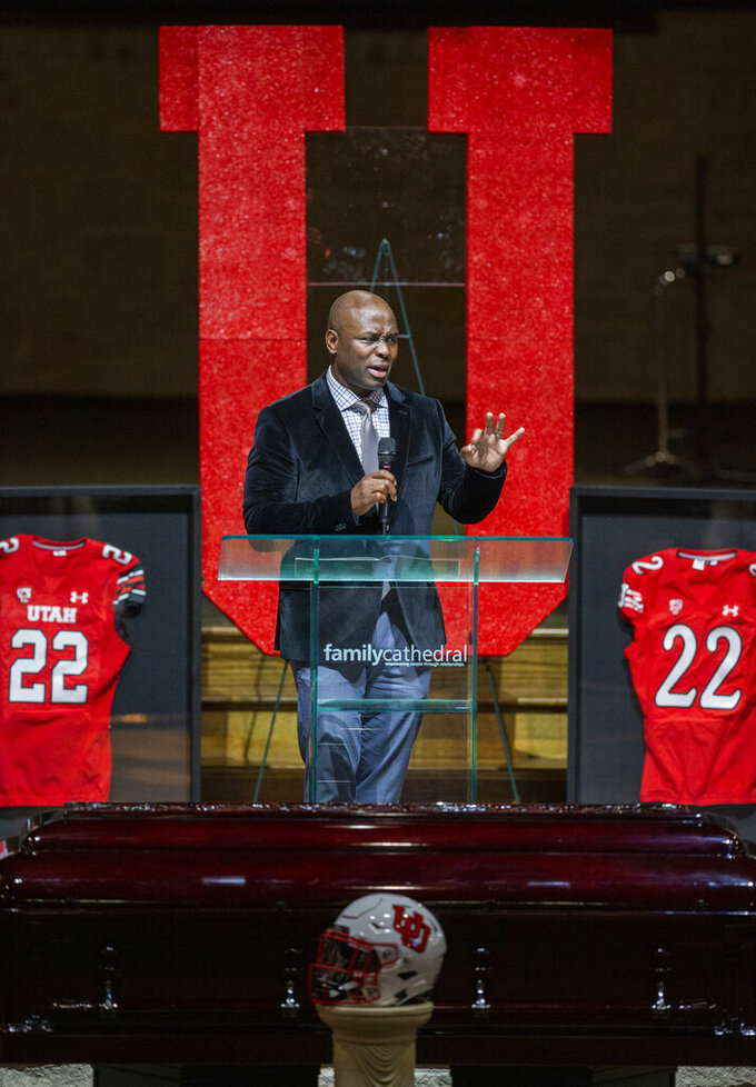Utah special teams coach Sharrieff Shah memorializes Aaron Lowe during a funeral service at Family Cathedral of Praise, Monday, Oct. 11, 2021, in Mesquite, Texas. Lowe, a student and football player at the University of Utah, was was shot and killed on Sept. 26 at a post-game party. (AP Photo/Brandon Wade)