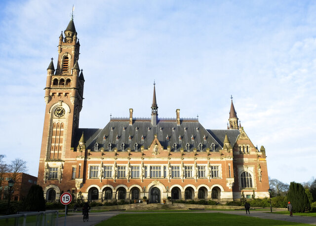 Exterior view of the Peace Palace housing the World Court in The Hague, Netherlands, Monday, Feb. 17, 2020. Lawyers for Equatorial Guinea told United Nations judges Monday that French authorities illegally seized a mansion in Paris which they insist operated as the African nation's embassy. The building was seized as part of a money laundering investigation into the son of the central African nation's president. (AP Photo/Mike Corder)