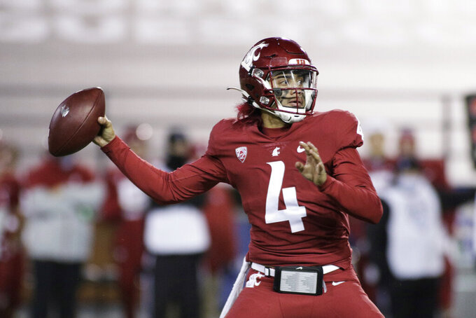 Washington State quarterback Jayden de Laura (4) throws a pass during the second half of the team's NCAA college football game against Oregon in Pullman, Wash., Saturday, Nov. 14, 2020. Oregon won 43-29. (AP Photo/Young Kwak)