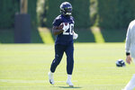 Seattle Seahawks running back Rashaad Penny carries the ball during NFL football practice Thursday, July 29, 2021, in Renton, Wash. (AP Photo/Ted S. Warren)