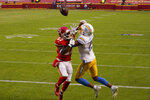 Kansas City Chiefs cornerback Rashad Fenton (27) breaks up a pass intended for Los Angeles Chargers wide receiver Jalen Guyton (15) during the first half of an NFL football game, Sunday, Jan. 3, 2021, in Kansas City. (AP Photo/Charlie Riedel)