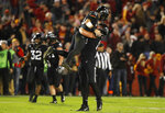 Iowa State quarterback Brock Purdy (15) celebrates with teammate tight end Dylan Soehner after an NCAA college football game against West Virginia, Saturday, Oct. 13, 2018, in Ames, Iowa. (AP Photo/Charlie Neibergall)