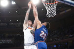 New York Knicks forward Kevin Knox II (20) stops Denver Nuggets forward Juan Hernangomez (41) from scoring during the first half of an NBA basketball game Thursday, Dec. 5, 2019, at Madison Square Garden in New York. (AP Photo/Mary Altaffer)