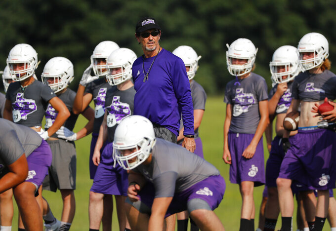 Coach Art Briles runs a practice at Mount Vernon High School, Monday, Aug. 5, 2019, in Mount Vernon, Texas. Briles was back at his roots Monday, coaching a high school football team in Texas after a season in Italy and more than three years after the two-time Big 12 champion coach was fired by Baylor in the wake of a sexual assault scandal. (AP Photo/Tony Gutierrez)