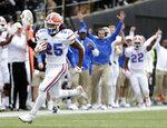 Florida running back Jordan Scarlett (25) runs 48-yards for a touchdown against Vanderbilt in the second half of an NCAA college football game Saturday, Oct. 13, 2018, in Nashville, Tenn. (AP Photo/Mark Humphrey)