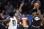 Team LeBron's LeBron James, of the Cleveland Cavaliers, shoots over Team Giannis' Joel Embiid, of the Philadelphia 76ers, during the second half of an NBA All-Star basketball game, Sunday, Feb. 17, 2019, in Charlotte, N.C. (AP Photo/Gerry Broome)