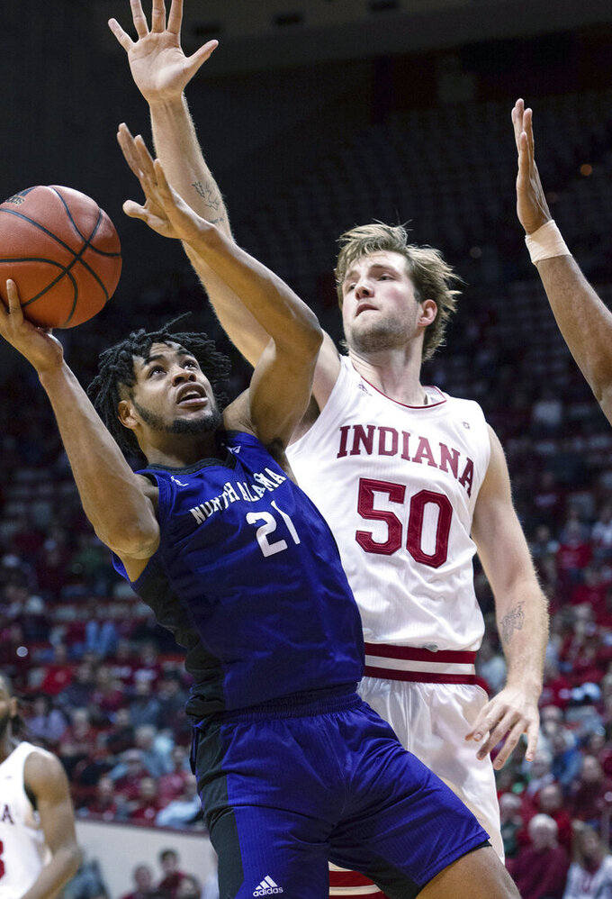 North Alabama's Emanuel Littles (21) slips past the defense of Indiana's Joey Brunk (50) during the second half of an NCAA college basketball game, Tuesday, Nov. 12, 2019, in Bloomington, Ind. Indiana won 91-65. (AP Photo/Doug McSchooler)
