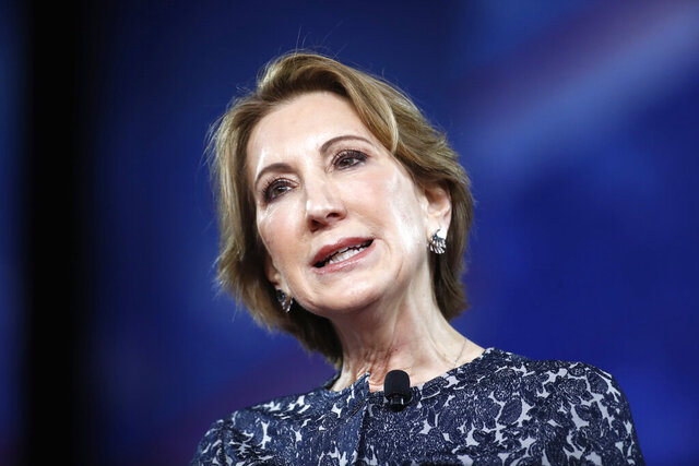 """FILE - In this Feb. 24, 2017 file photo, former 2016 GOP presidential candidate Carly Fiorina in Oxon Hill, Md.  Fiorina says """"it is vital"""" that President Donald Trump is impeached, but she didn't go so far as to say he should be removed from office. The Democratic-led House is expected to vote Wednesday to approve two impeachment articles, though the president's removal by the Republican-led Senate appears unlikely. (AP Photo/Alex Brandon)"""
