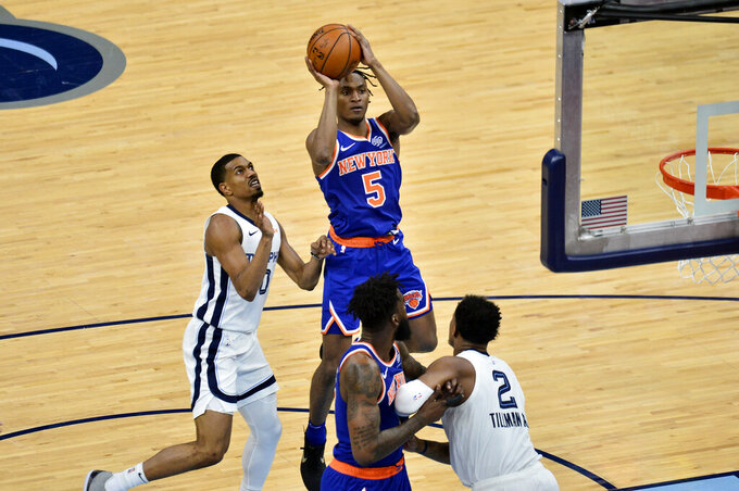 New York Knicks guard Immanuel Quickley (5) shoots ahead of Memphis Grizzlies guard De'Anthony Melton (0) in the second half of an NBA basketball game Monday, May 3, 2021, in Memphis, Tenn. (AP Photo/Brandon Dill)