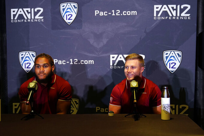 CORRECTS TO WASHINGTON STATE NOT WASHINGTON AS ORIGINALLY SENT - Washington State running back Max Borghi, right, and linebacker Jahad Woods field questions during the Pac-12 Conference NCAA college football Media Day Tuesday, July 27, 2021, in Los Angeles. (AP Photo/Marcio Jose Sanchez)