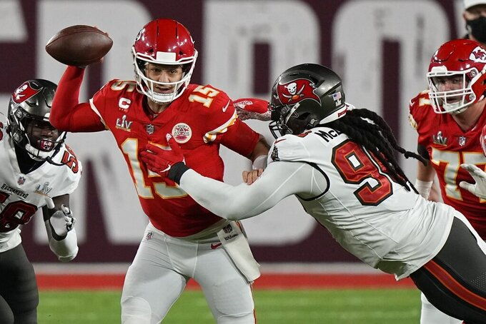 Tampa Bay Buccaneers nose tackle Steve McLendon pressures Kansas City Chiefs quarterback Patrick Mahomes during the first half of the NFL Super Bowl 55 football game Sunday, Feb. 7, 2021, in Tampa, Fla. (AP Photo/David J. Phillip)