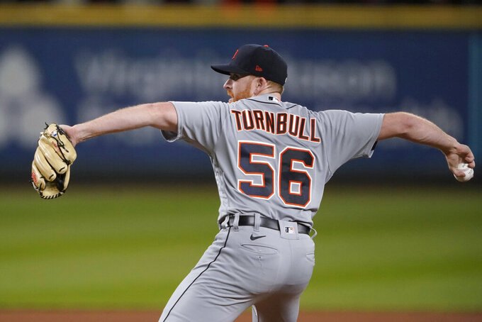 Detroit Tigers starting pitcher Spencer Turnbull winds up during the eight inning against the Seattle Mariners in a baseball game Tuesday, May 18, 2021, in Seattle. (AP Photo/Ted S. Warren)