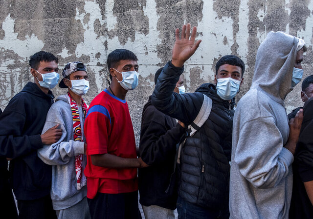 Migrants arrive at the Arguineguin port in Gran Canaria island, Spain, after being rescued in the Atlantic Ocean by emergency workers on Wednesday, Oct. 18, 2020. Under increasing pressure from the steady build-up of Africans' arrivals to its southern Canary Islands, the Spanish government has launched an all-front offensive, including active diplomacy, to avoid becoming the next black spot on Europe's failing record handling migration flows. (AP Photo/Javier Bauluz)