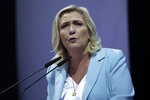Marine Le Pen gestures delivers a speech, at a National Rally event in Frejus, France, Sunday, Sept. 12, 2021. Two politicians have formally declared their intentions to seek to become France's first female president in next year's spring election. National Rally's Marine Le Pen and Paris' Socialist mayor, Anne Hidalgo, both officially launched their campaigns Sunday in what were widely expected moves. (AP Photo/Daniel Cole)