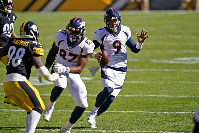 Denver Broncos quarterback Jeff Driskel (9) runs for the sideline during the second half of an NFL football game against the Pittsburgh Steelers, Sunday, Sept. 20, 2020, in Pittsburgh.  (AP Photo/Keith Srakocic)