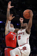 St. John's guard Shamorie Ponds (2) goes up for a shot against DePaul guard Devin Gage (3) during the first half of an NCAA college basketball game in the Big East men's tournament, Wednesday, March 13, 2019, in New York. (AP Photo/Julio Cortez)