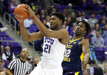 TCU center Kevin Samuel (21) grabs a pass in front of West Virginia forward Andrew Gordon (12) in the first half of an NCAA college basketball game, Tuesday, Jan. 15, 2019, in Fort Worth, Texas. (AP Photo/Tony Gutierrez)