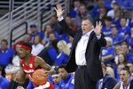 Creighton coach Greg McDermott calls instructions behind Nebraska's Dachon Burke Jr. (11) during the first half of an NCAA college basketball game in Omaha, Neb., Saturday, Dec. 7, 2019. (AP Photo/Nati Harnik)